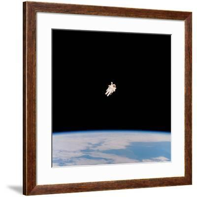 Floating Astronaut--Framed Photographic Print