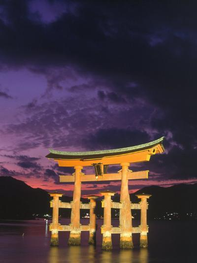 Floating Torii with Dark Clouds, Japan-Walter Bibikow-Photographic Print