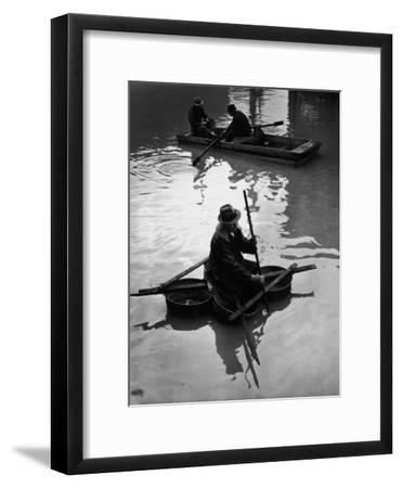 Flood Victim Paddling Boat Fashioned Out of Four Washtubs in the Flood Waters of Mississippi River-Margaret Bourke-White-Framed Premium Photographic Print