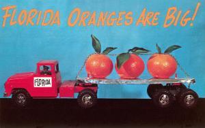 Florida Oranges Are Big, Three Oranges on Toy Flatbed