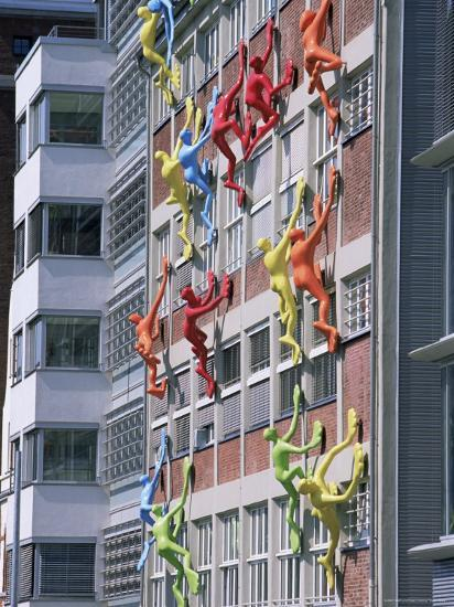 Flossies Figures Covering a Building Facade at the Medienhafen, Dusseldorf, North Rhine Westphalia-Yadid Levy-Photographic Print