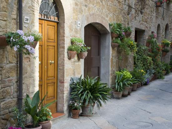 Flower Pots and Potted Plants Decorate a Narrow Street in Tuscan Village, Pienza, Italy-Dennis Flaherty-Photographic Print