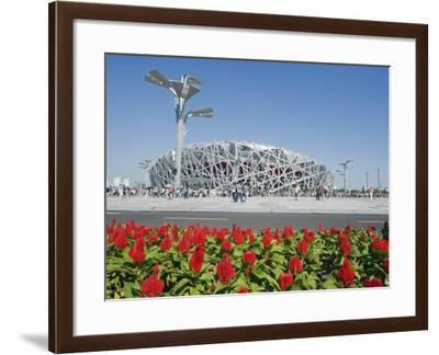 Flowers and the Birds Nest National Stadium in the Olympic Green, Beijing, China-Kober Christian-Framed Photographic Print
