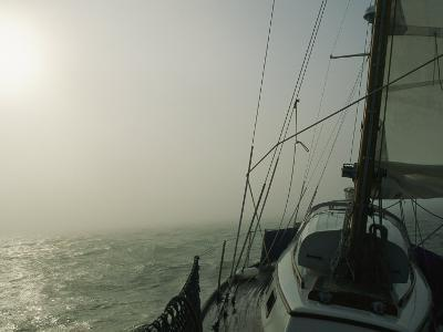 Fog Blankets a Sailboat in San Francisco Bay-Rich Reid-Photographic Print