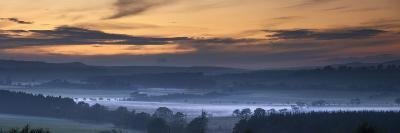 Fog Lies over a Town at Sunset; Swarland, Northumberland, England-Design Pics Inc-Photographic Print