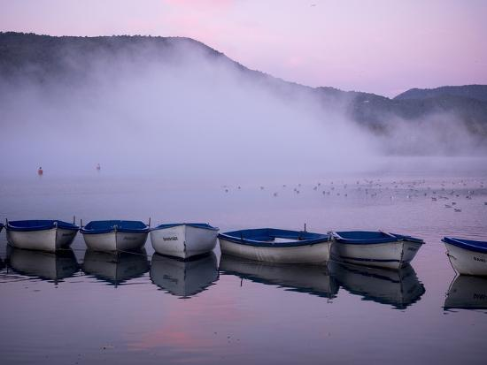 Fog rises from the water's surface at sunrise.-Tino Soriano-Photographic Print