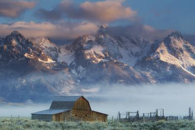 https://imgc.artprintimages.com/img/print/fog-rolls-in-around-the-mormon-row-historic-district-and-the-snow-capped-teton-range_u-l-pncv7h0.jpg?p=0