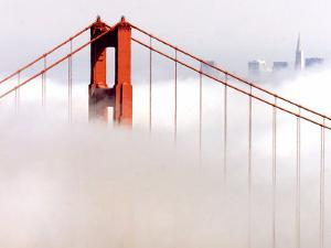 Fog Swirls and Covers All of Golden Gate Bridge Save the North Tower and the Tips of Skyscrapers