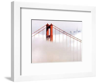 Fog Swirls and Covers All of Golden Gate Bridge Save the North Tower and the Tips of Skyscrapers--Framed Photographic Print