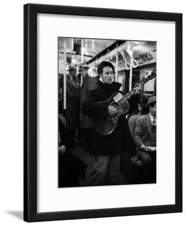 Folk Singer Woody Guthrie Singing Aboard a Subway Train