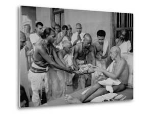 Followers Offering Fruits to Sri Ramana Maharshi