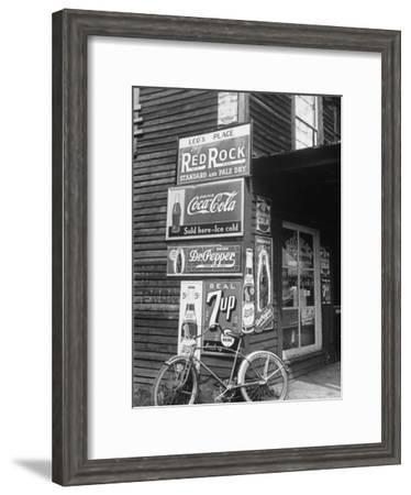 Food Store Called Leo's Place Covered with Beverage Ads Incl. Coca Cola, 7 Up, Dr. Pepper and Pepsi-Alfred Eisenstaedt-Framed Premium Photographic Print
