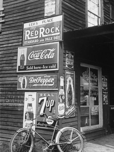 Food Store Called Leo's Place Covered with Beverage Ads Incl. Coca Cola, 7 Up, Dr. Pepper and Pepsi-Alfred Eisenstaedt-Photographic Print