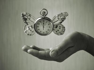 Stopwatch With Butterfly Wings Levitating Above Hand, Black And White, Slight Green Toning