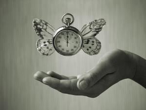 Stopwatch With Butterfly Wings Levitating Above Hand, Black And White, Slight Green Toning by foodbytes