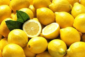 Many Whole Lemons with One Halved (Full Frame) by Foodcollection