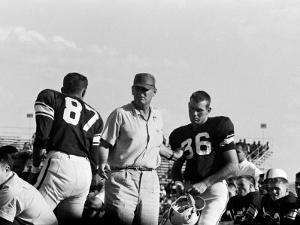 Football Coach Paul Bear Bryant of Texas A&M Talking W. Players During a Game