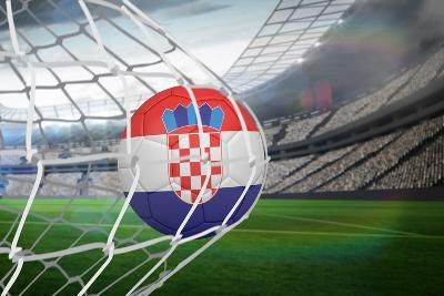 Football in Croatia Colours at Back of Net against Large Football Stadium with Lights-Wavebreak Media Ltd-Photographic Print