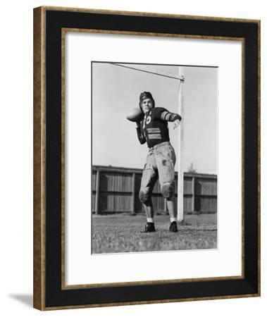 Football Player Throwing Ball--Framed Photo