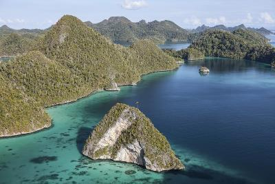 Forest-Covered Limestone Islands Surround a Lagoon in Raja Ampat-Stocktrek Images-Photographic Print