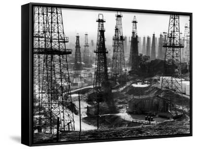 Forest of Wells, Rigs and Derricks Crowd the Signal Hill Oil Fields-Andreas Feininger-Framed Canvas Print