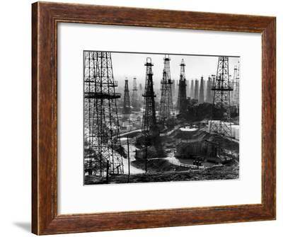 Forest of Wells, Rigs and Derricks Crowd the Signal Hill Oil Fields-Andreas Feininger-Framed Premium Photographic Print