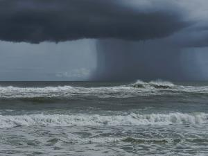 Dark Dramatic Shot of Tropical Storm Coming Ashore at Pensacola, Florida Beach. Water Spout Descend by forestpath
