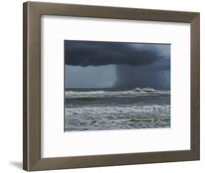 Dark Dramatic Shot of Tropical Storm Coming Ashore at Pensacola, Florida Beach. Water Spout Descend