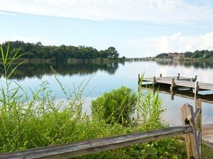 Fishing Pier and Boat Launch in Bayview Park on Bayou Texar in Pensacola, Florida in Early Morning by forestpath
