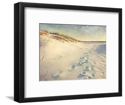 Footprints in the Sand Dunes Leading to the Ocean at Sunset. Soft Artistic Treatment with Canvas Te