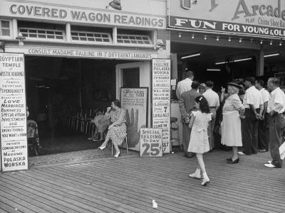 Fortune Teller Booth Next to a Penny Arcade on the Boardwalk in the Resort and Convention City-Alfred Eisenstaedt-Photographic Print