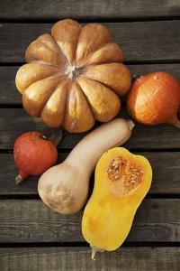 Pumpkin, Butternut- and Hokkaido Squashes on Wooden Background by Fotos mit Geschmack