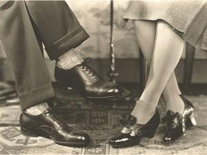 Man's and Woman's Feet and Shoes by Found Image Press