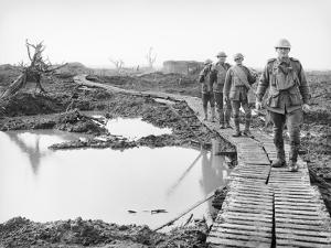 Four Australian Soldiers Walking Along the Duckboard Track at Tokio