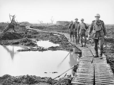 Four Australian Soldiers Walking Along the Duckboard Track at Tokio--Photographic Print