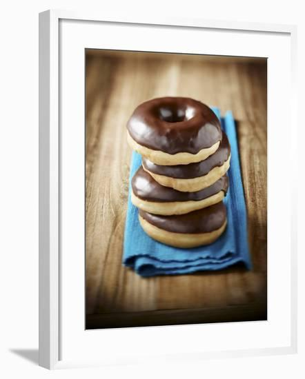 Four Doughnuts with Chocolate Glaze, Stacked-Michael Löffler-Framed Photographic Print