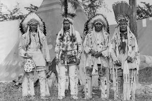 Four Native American Chiefs in Traditional Clothing and Feathered Bonnet