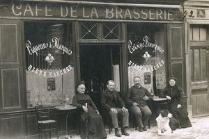 Four People and a Dog Outside a Cafe, France