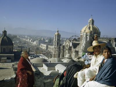 Four People Sit on Rooftop Overlooking Our Lady of Guadalupe Church-Justin Locke-Photographic Print