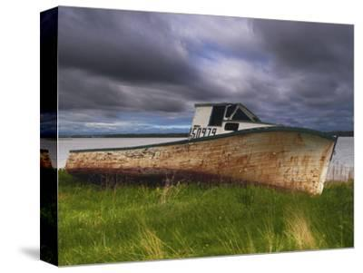 Old Rusty Lobster Boat on a Grassy Bank by the Ocean in Nova Scotia