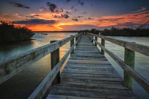 Sunset over a Fishing Pier in Wildcat Cove, Florida by Frances Gallogly