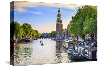 Netherlands, North Holland, Amsterdam. Montelbaan Tower at Oude Schans