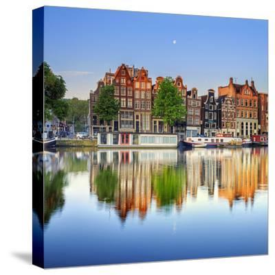 Netherlands, North Holland, Amsterdam. Typical Houses and Houseboats on Amstel River