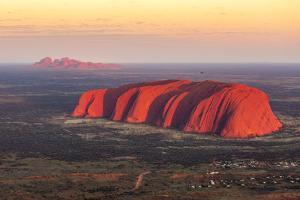 Uluru and Kata Tjuta at sunrise, Aerial view. Northern Territory, Australia by Francesco Riccardo Iacomino