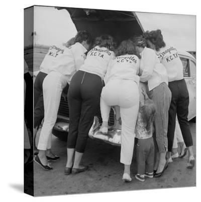 "All-Girl ""Dragettes"" Hotrod Club Working on Car Engine, Kansas City, Kansas, 1959"