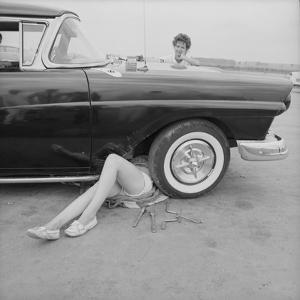 """All-Girl """"Dragettes"""" Hotrod Club Working on Car Engine with Children, Kansas City, Kansas, 1959 by Francis Miller"""