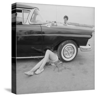 "All-Girl ""Dragettes"" Hotrod Club Working on Car Engine with Children, Kansas City, Kansas, 1959"