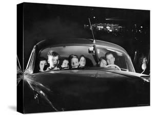 Carload of Happy Movie Fans Incl. Parents with Their Kids Who Get in Free by Francis Miller