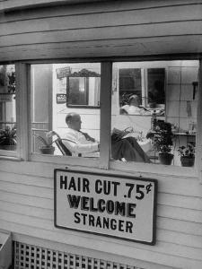Man Waiting in a Barber Shop For a Haircut by Francis Miller