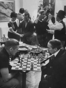 Men Playing Chess at a Cocktail Party by Francis Miller